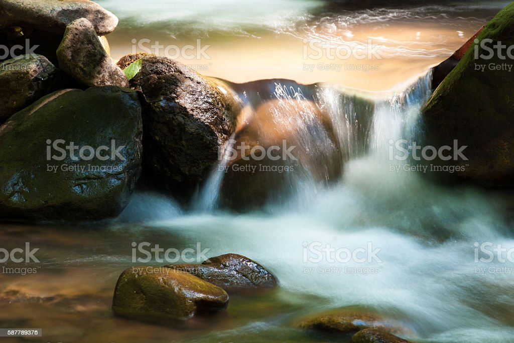 Small waterfall on river. stock photo