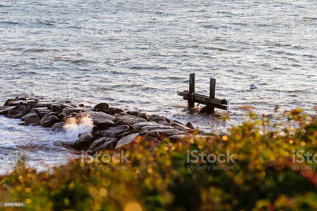 Small wave small jetty stock photo