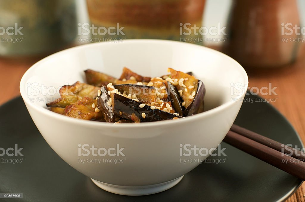 Small White Bowl of Asian Eggplant with Chopsticks royalty-free stock photo