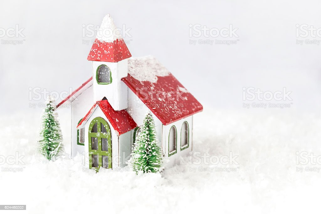 small white church with red roof on white background. stock photo