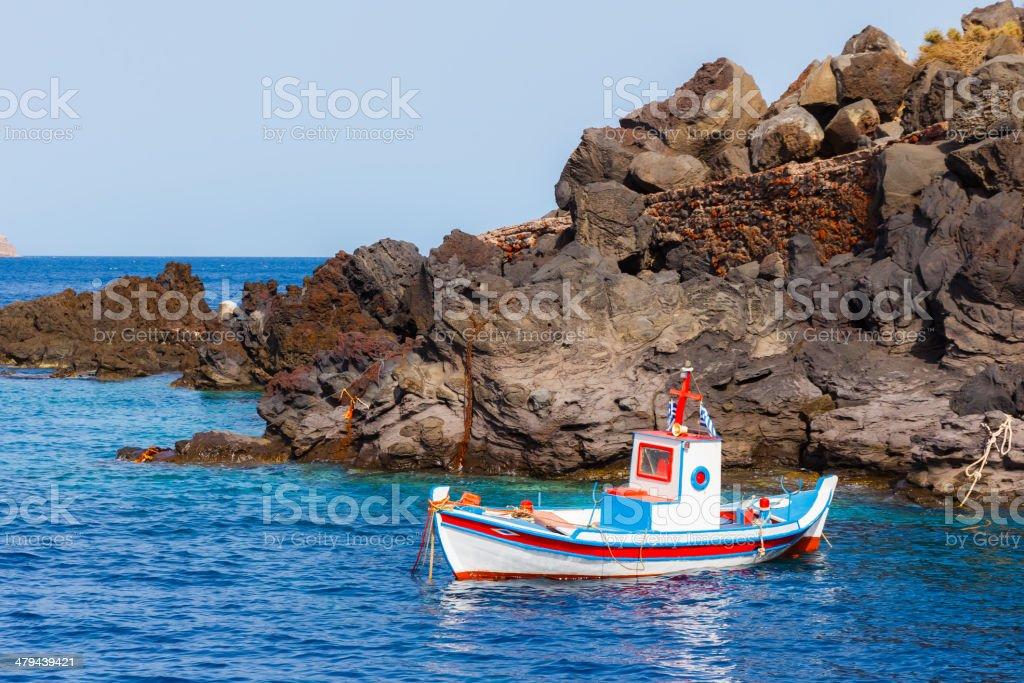 Small white fishing boat in Santorini, Greece stock photo