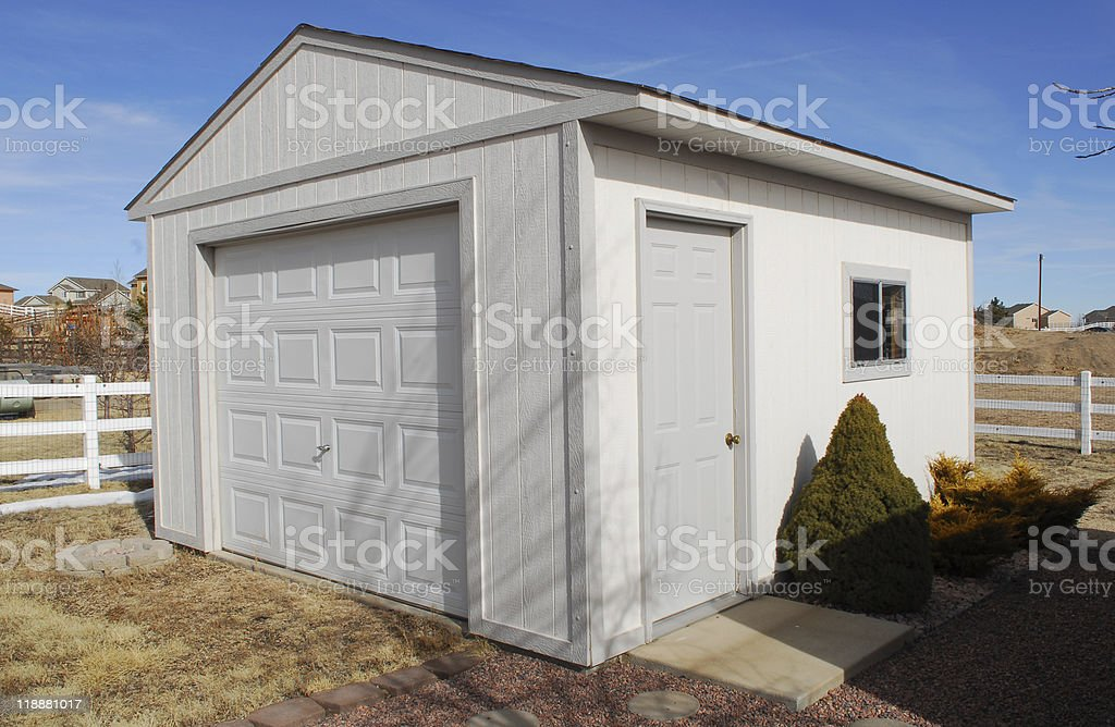 Small white garage on backyard stock photo