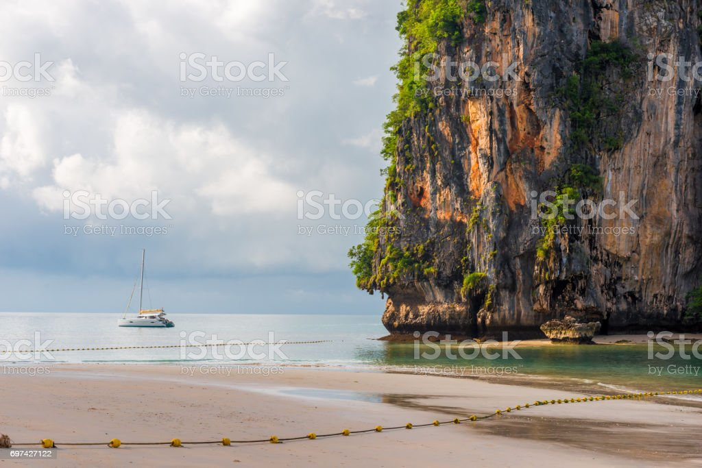 A small white yacht off the coast of Krabi Province, Thailand stock photo