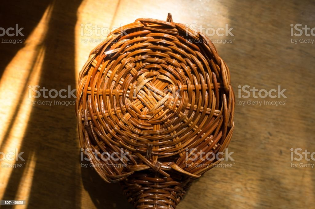 Small wickerwork on wooden table from above stock photo