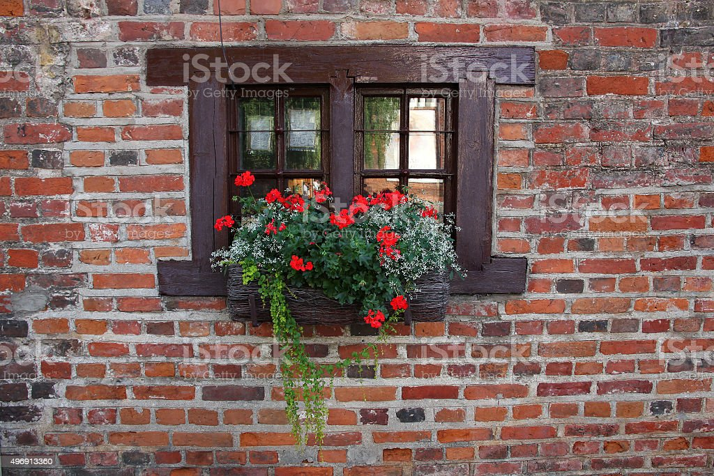 Small widow of old medieval house. stock photo