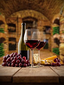Small wine cellar with two glasses and botte of wine