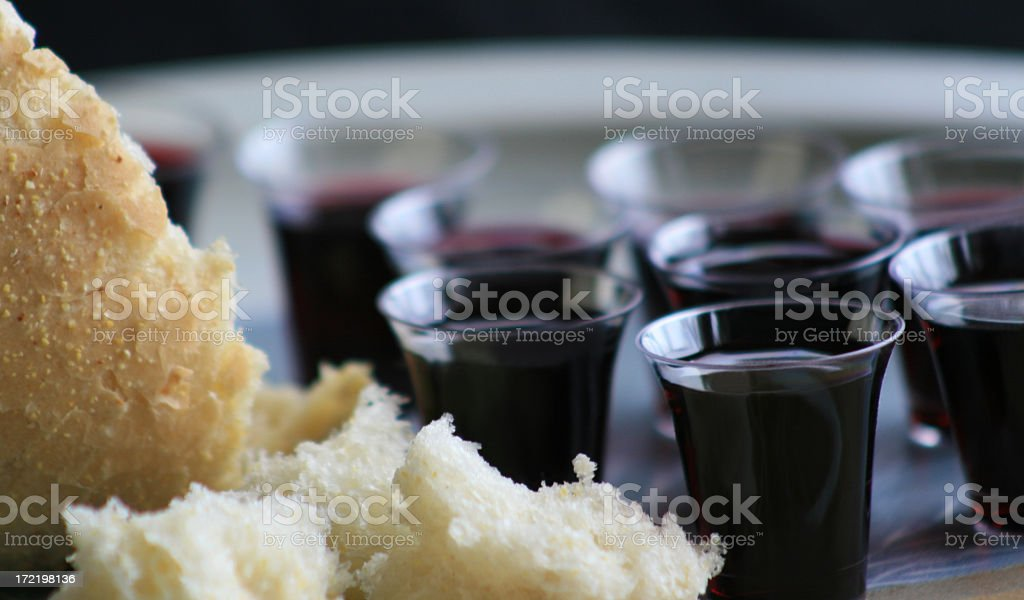 Small Wine Cups and Broken Bread for Communion stock photo