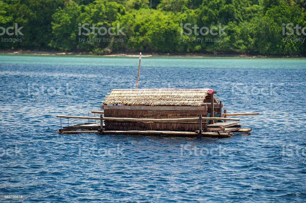 Small wood floating fishing platform in sulawesi indonesia stock photo