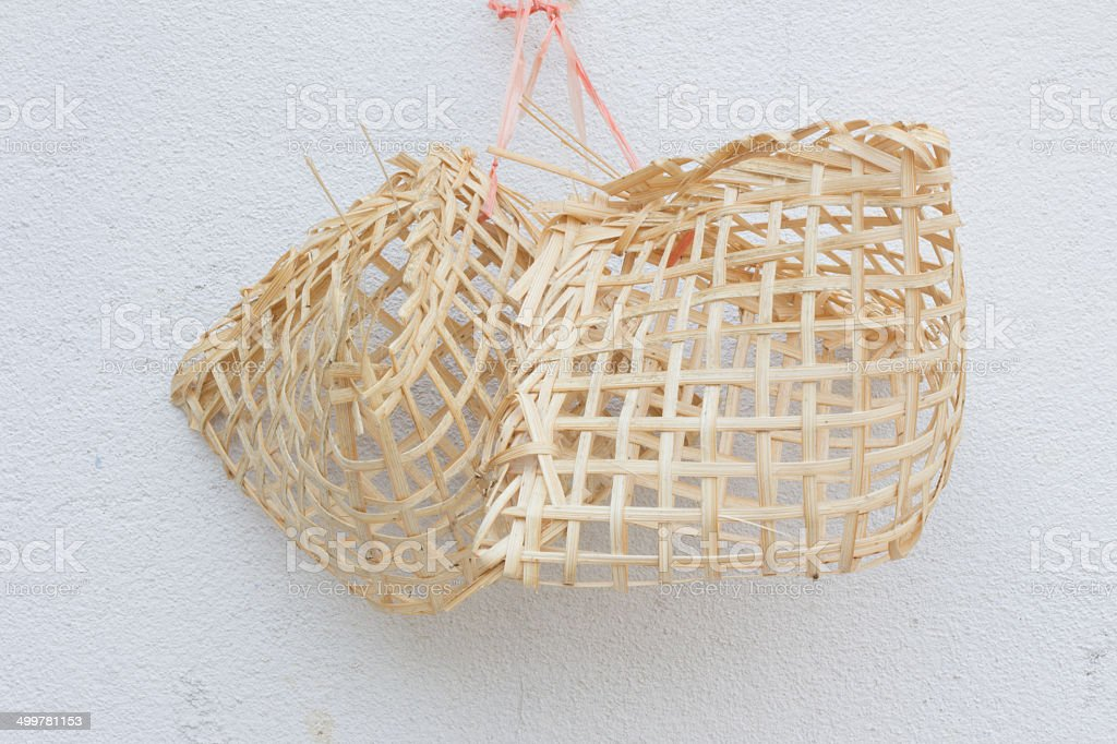 small wooden birdcages on the white wall stock photo