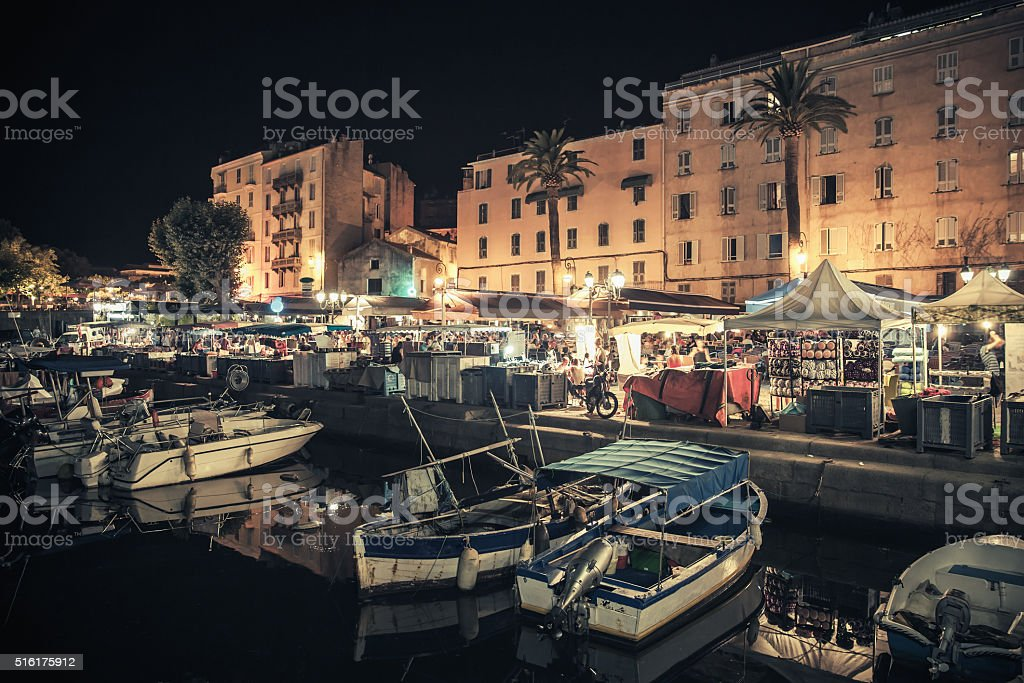 Small wooden boats moored in Ajaccio at night stock photo
