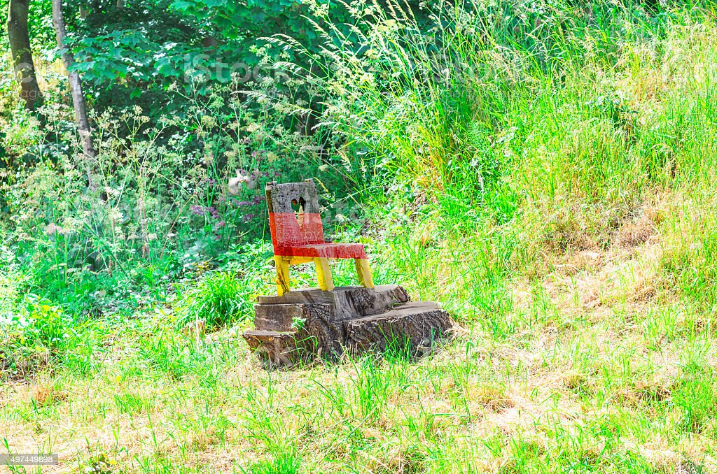 Small wooden chair in national colors of Germany. stock photo
