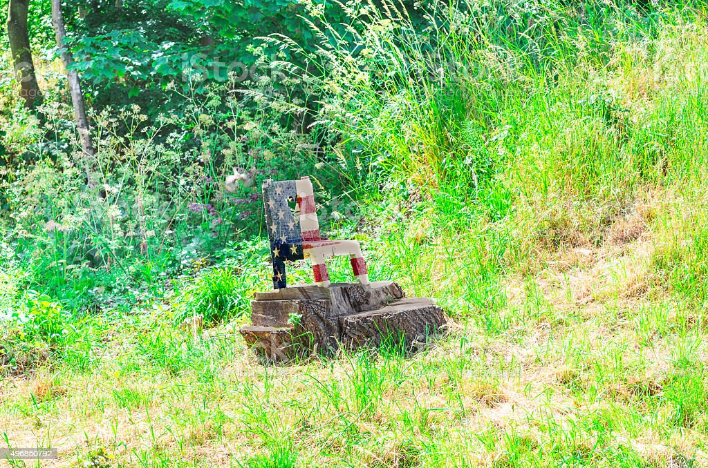 Small wooden chair in national colors of the USA stock photo
