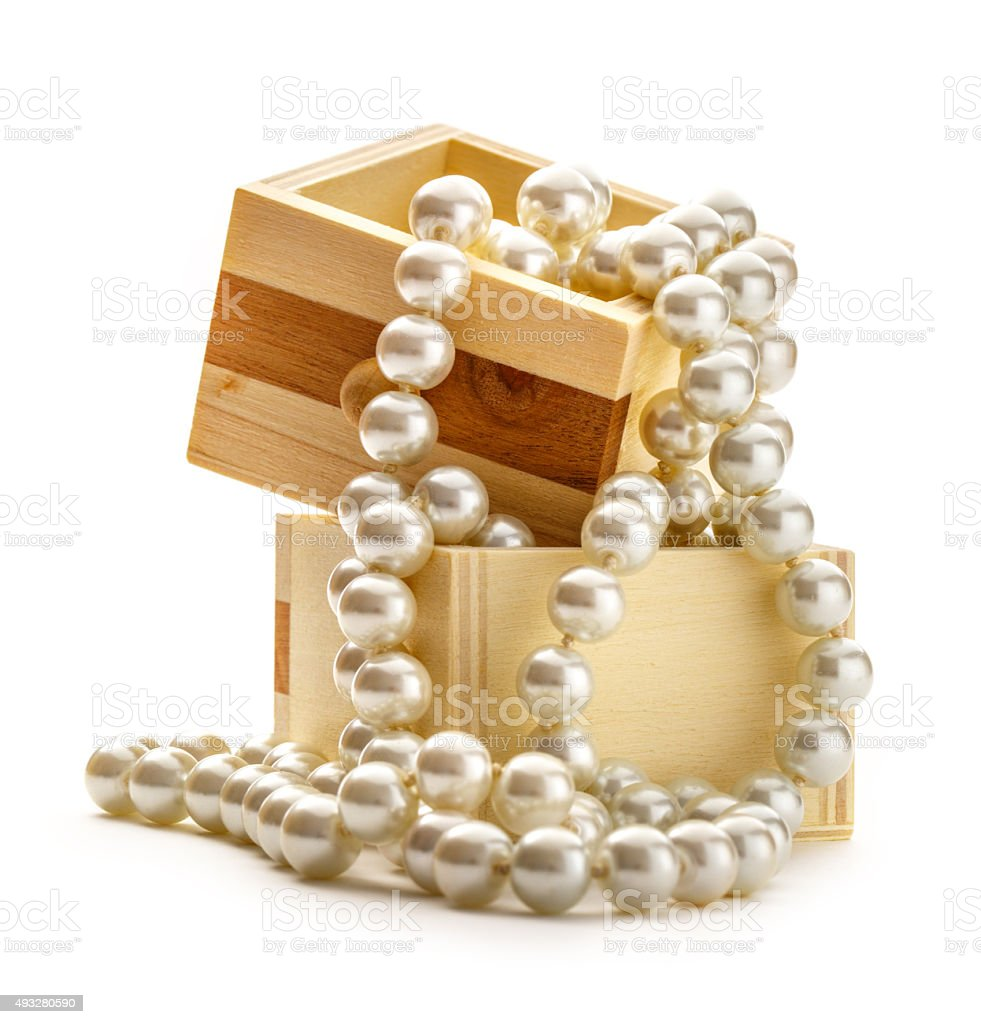 Small wooden chest with white pearl stock photo