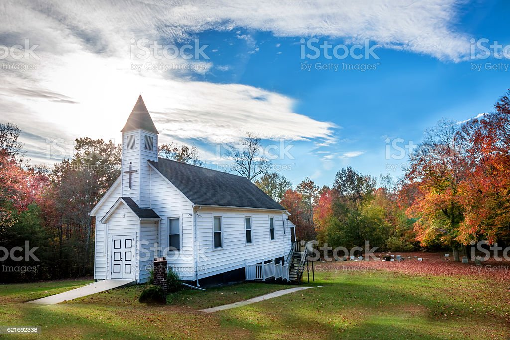 Small Wooden Church in the countryside during Autumn stock photo