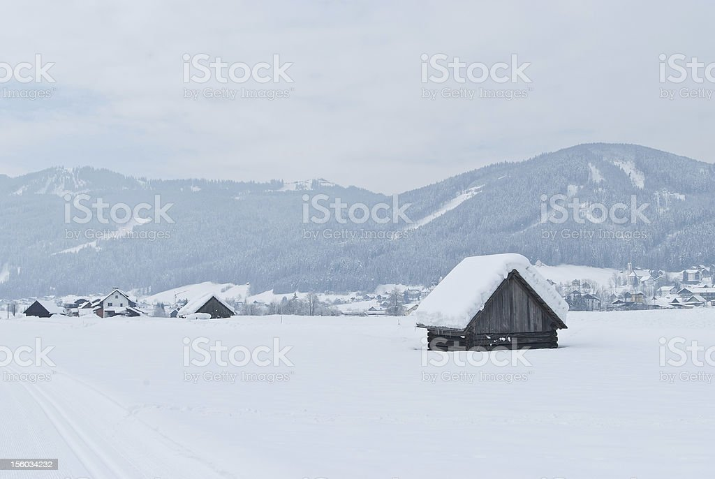Small wooden cottages in winter wonderland royalty-free stock photo