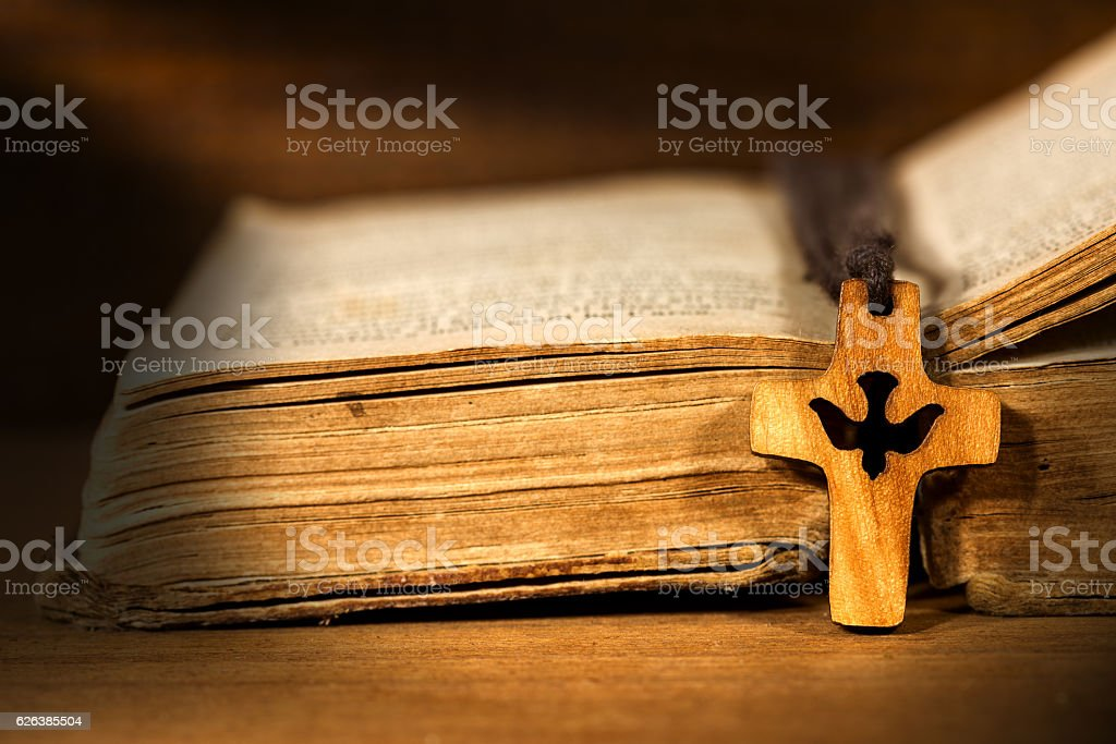 Small Wooden Crucifix with Dove and Bible stock photo
