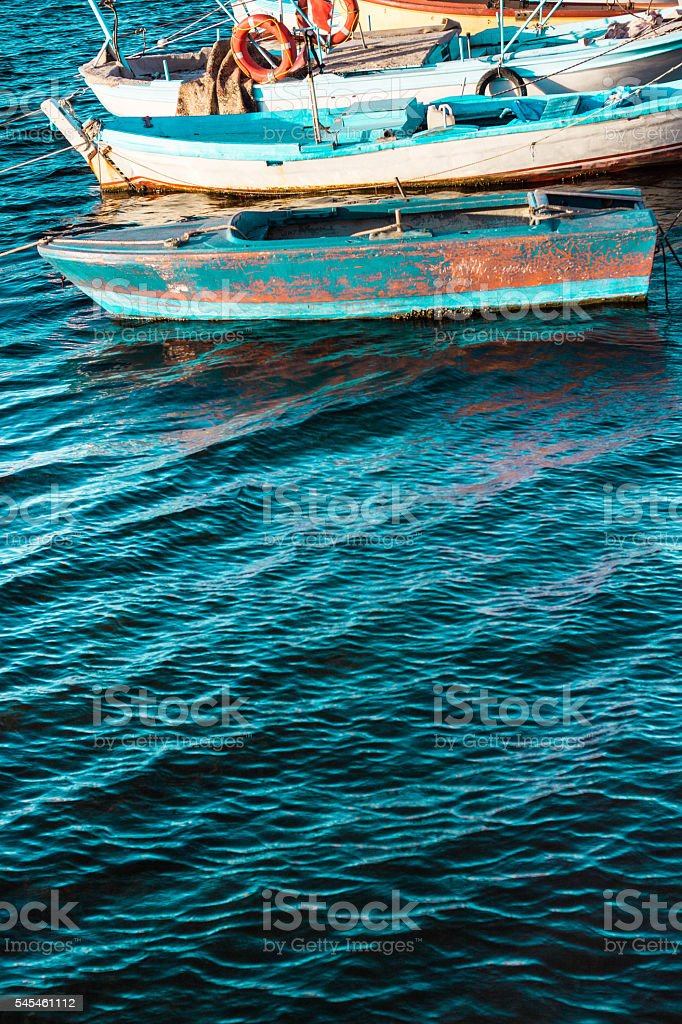 Small Wooden Fishing Boats on the Water stock photo