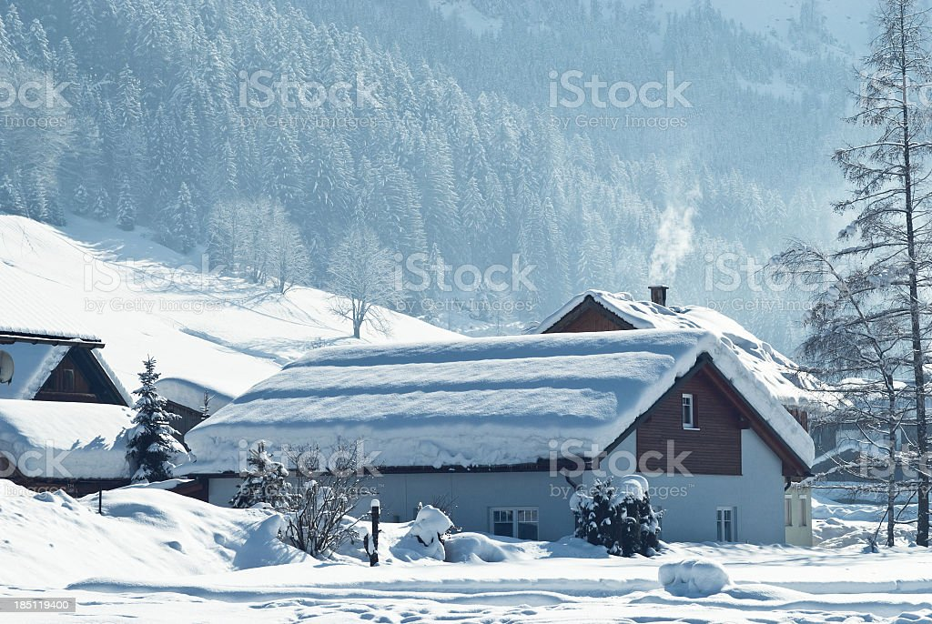 Small wooden holiday houses in winter wonderland royalty-free stock photo