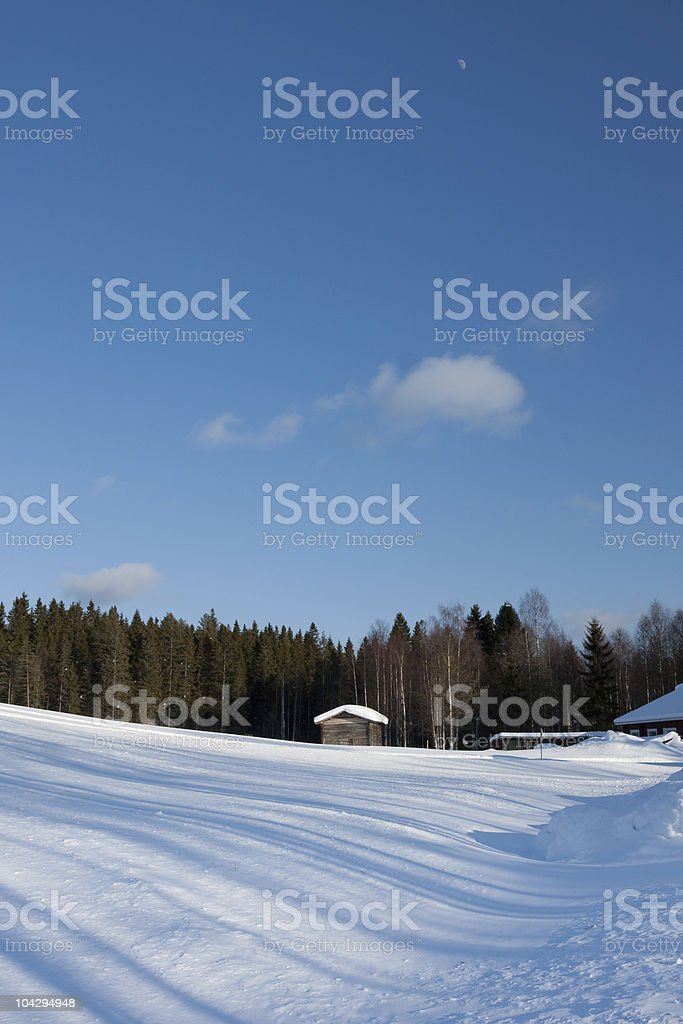 Small wooden house in winter stock photo