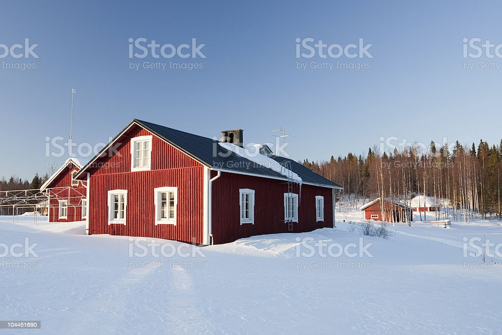 Small wooden houses in winter royalty-free stock photo