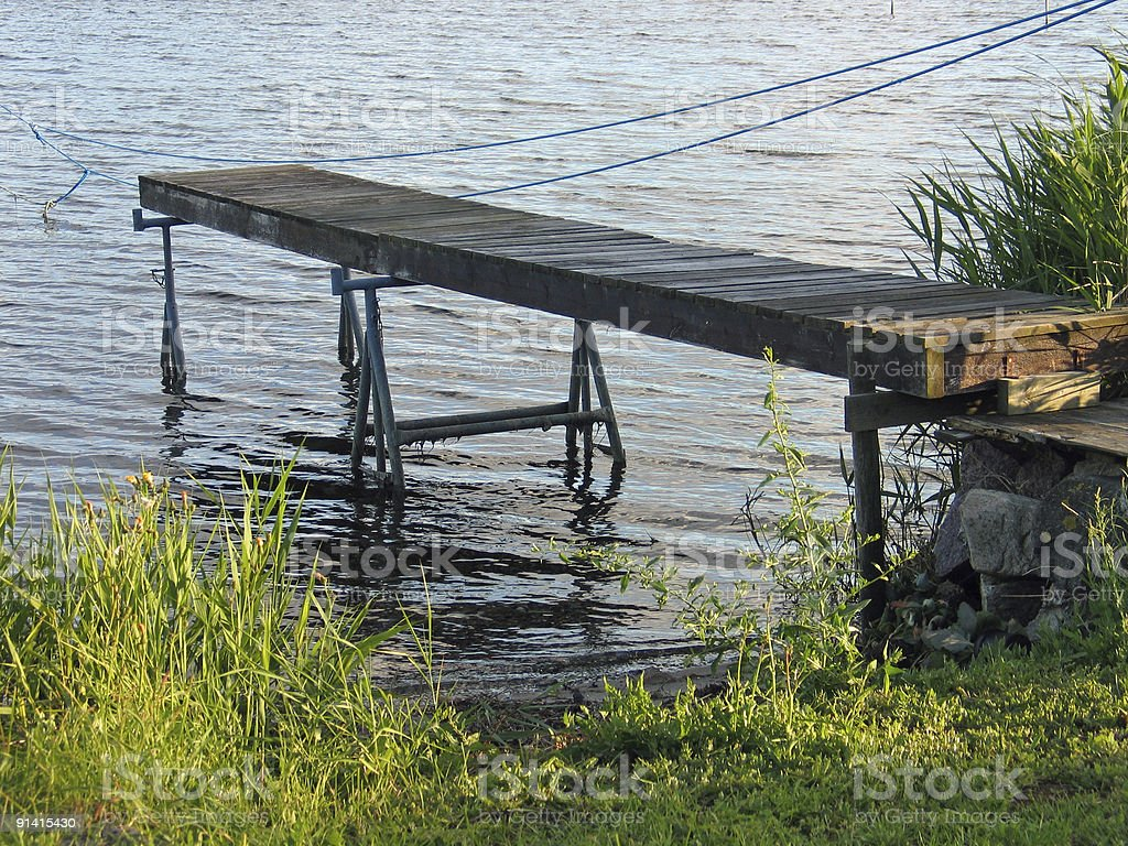 Small wooden jetty dock royalty-free stock photo