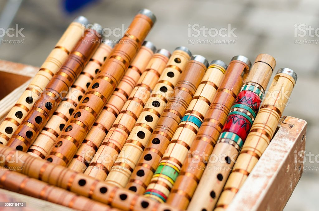 Small wooden penny trumpets on sale. wooden reed stock photo