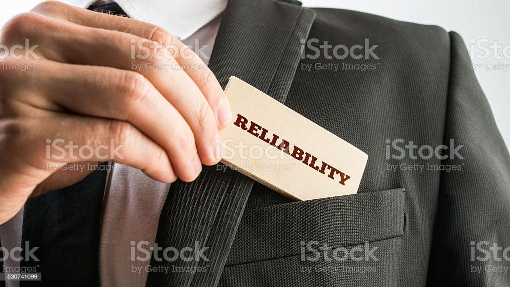 Small Wooden Piece with Reliability Text stock photo