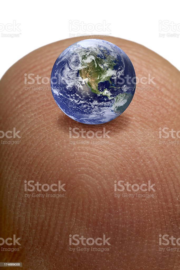 Small World After All; Tiny Planet Earth on Finger Tip stock photo