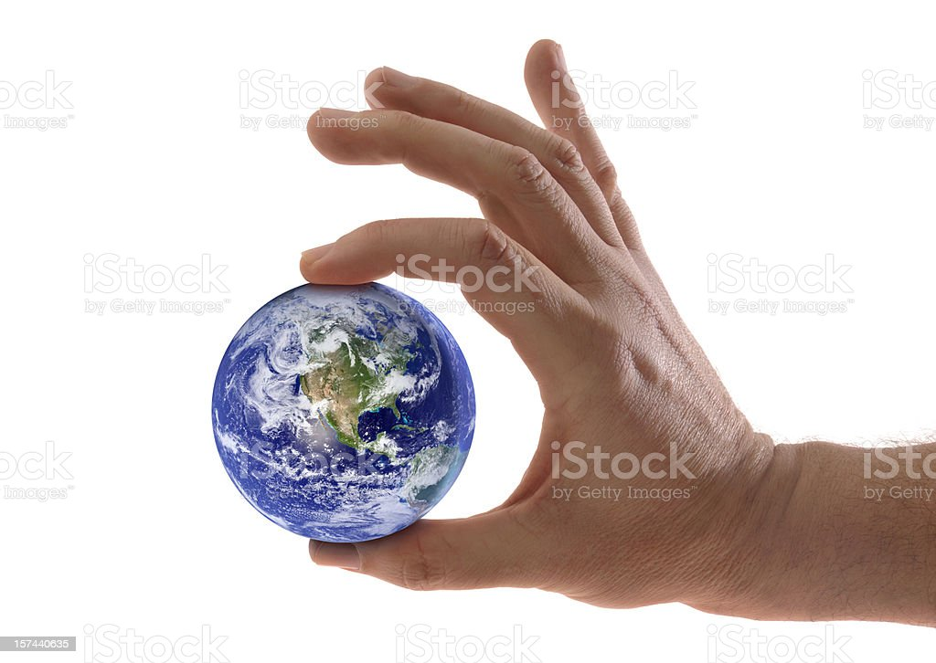 Small World, Planet Earth Held in Hand, Fingers Squeezing Globe stock photo