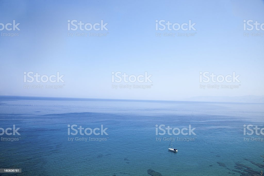 Small Yacht in huge sea. royalty-free stock photo