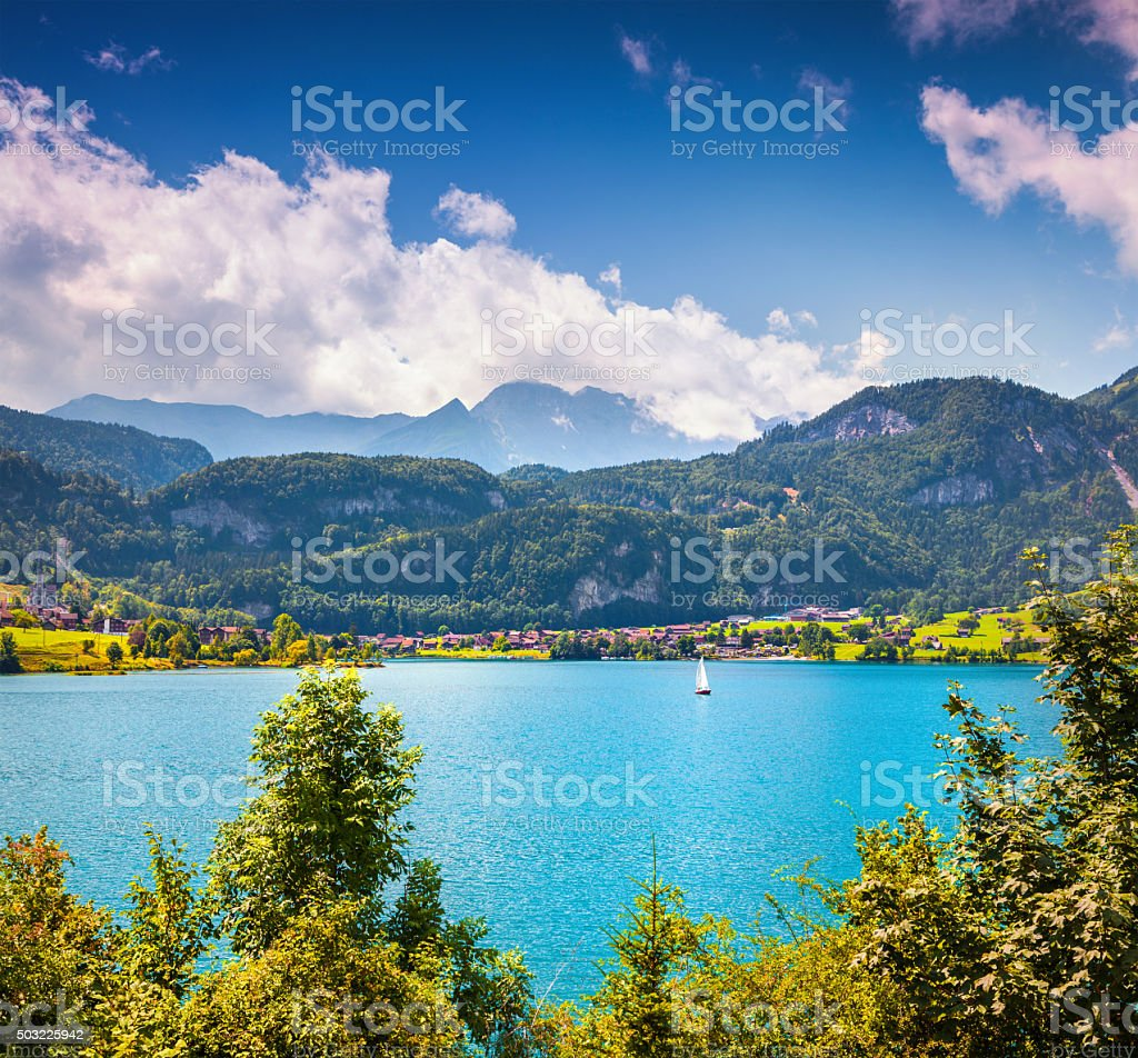 Small yacht on Lungerersee lake stock photo