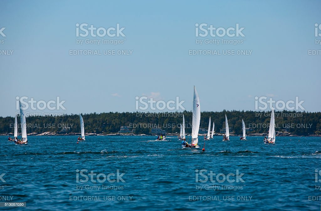 Small yachts sailing along the coast near Boothbay Harbor. stock photo