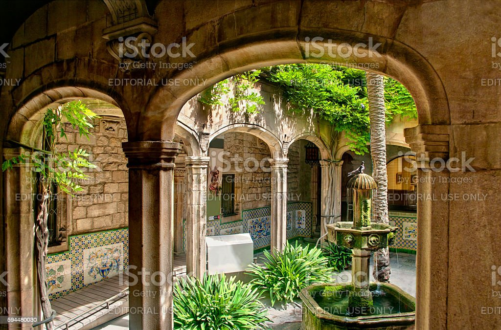 small yard with fountain, birds and plants inside church stock photo