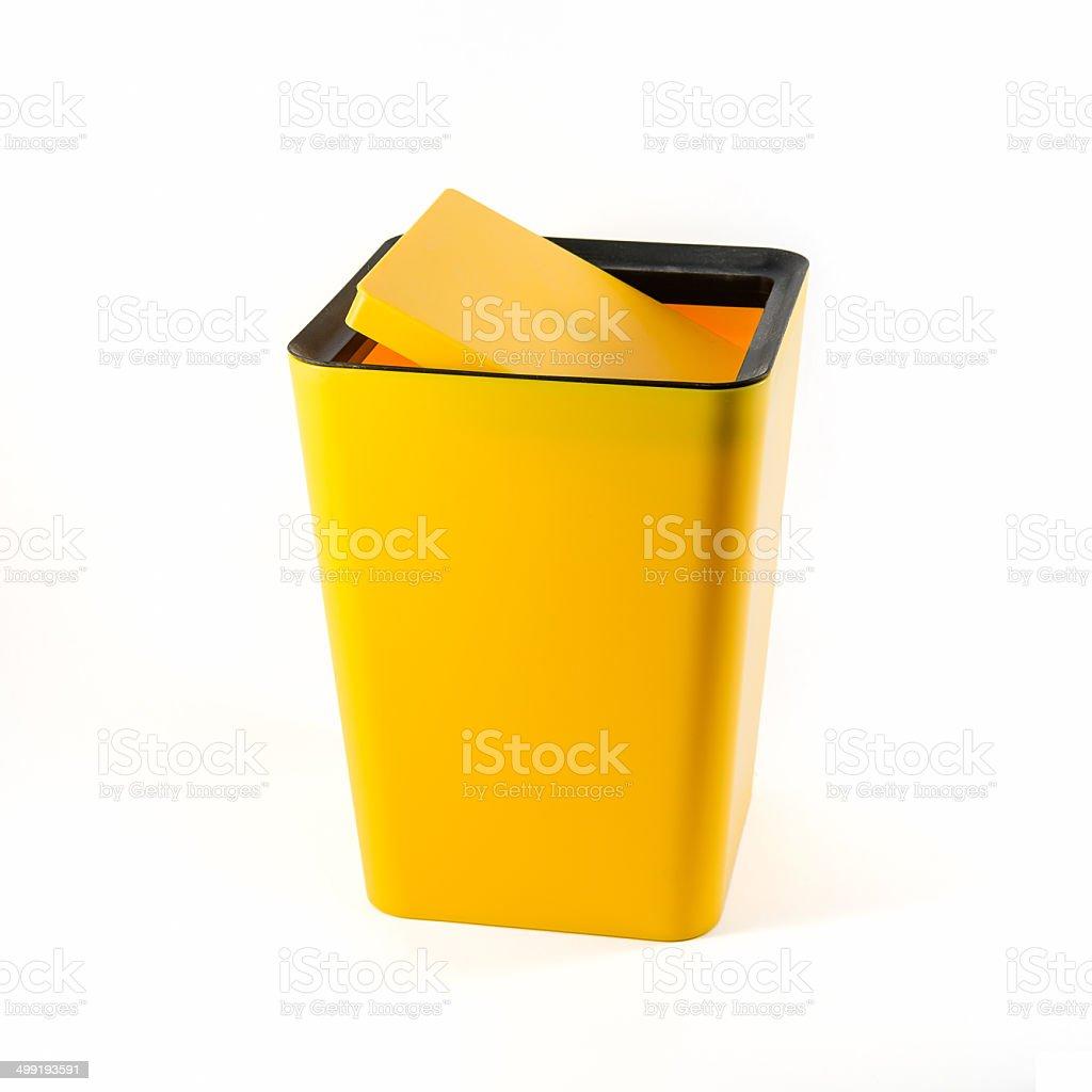 Small yellow plastic bin isolated stock photo
