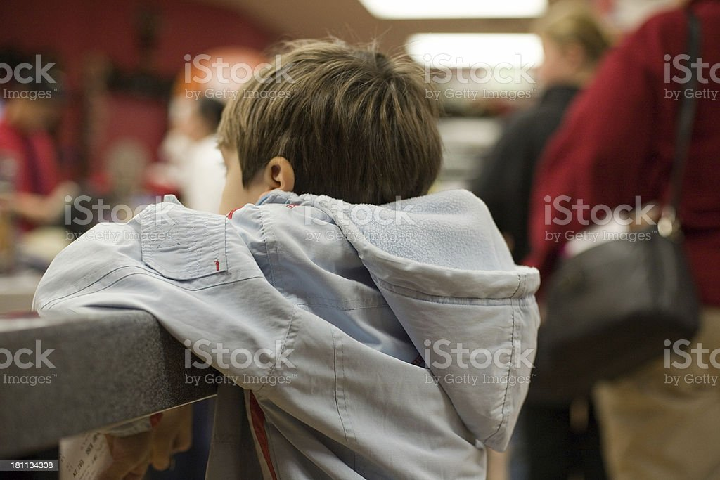 small young boy in jacket waiting stock photo