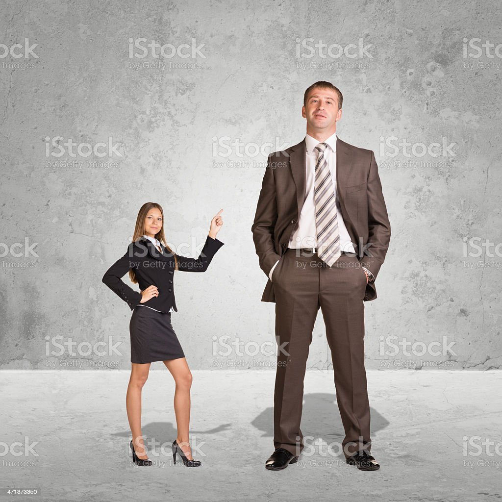 Small Young Businesswoman and Large Businessman stock photo