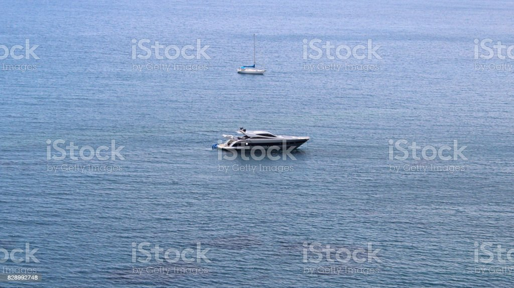 Smaller Unmarked Boats Floating on the Open Ocean stock photo