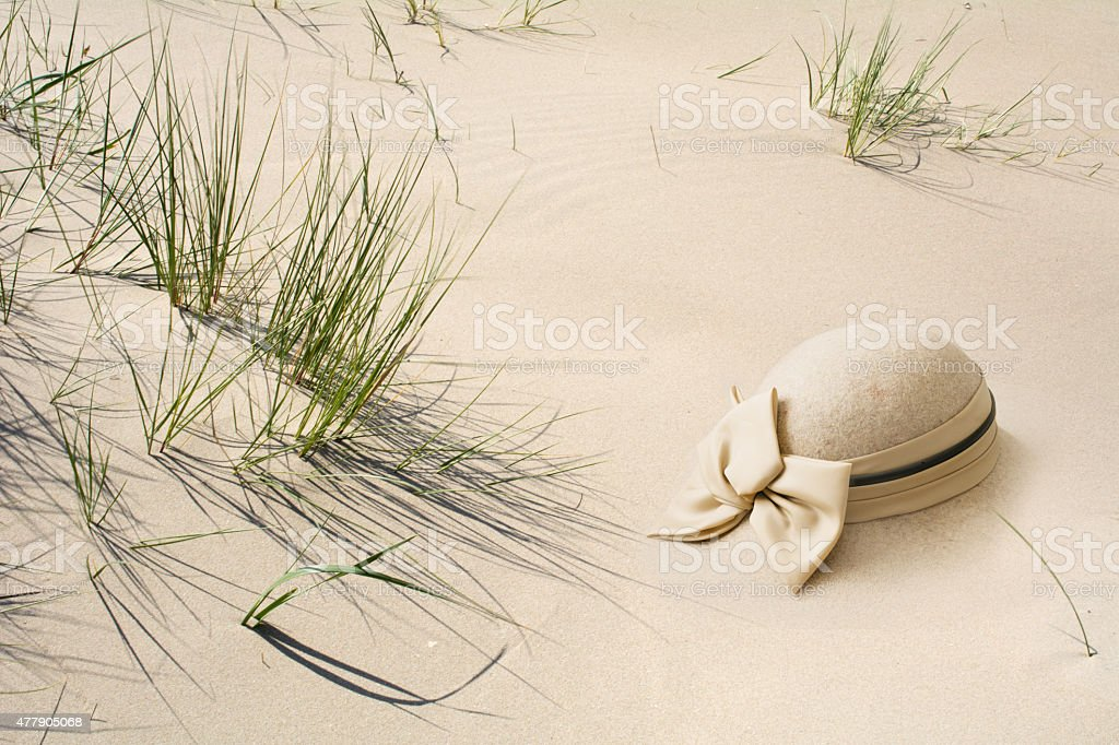 Smart bonnet in the sand stock photo