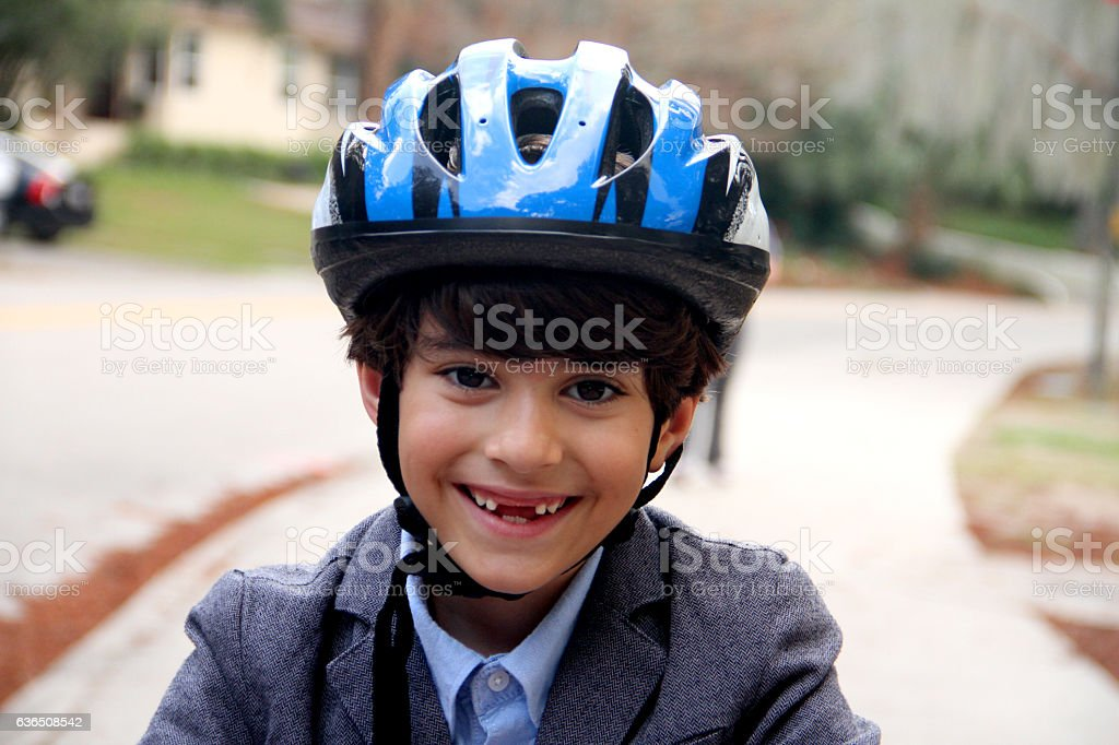 smart boy with blue safety helmet smiling with coat stock photo