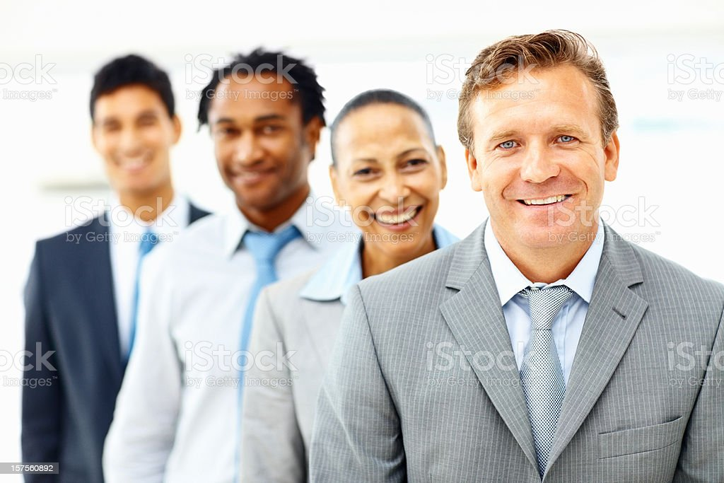 Smart busines man with colleagues at the background royalty-free stock photo