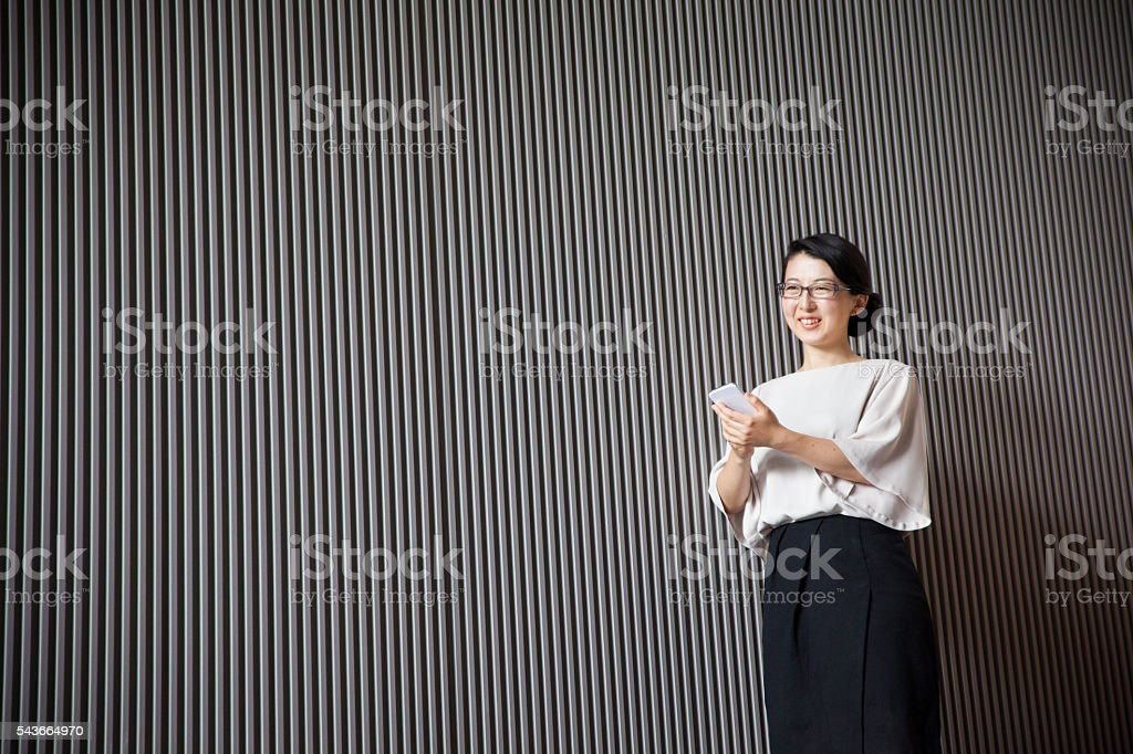 Smart business executive works on her mobile phone stock photo