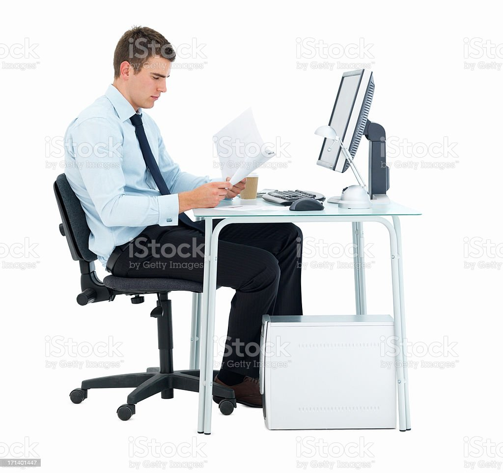 Smart business man at office desk isolated on white royalty-free stock photo