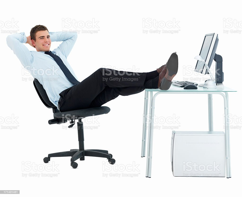 Smart business man relaxing at office desk isolated on white royalty-free stock photo
