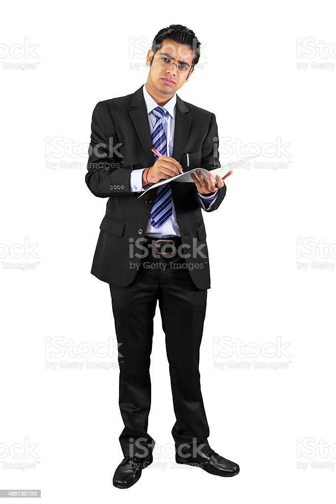Smart business man writing on papers stock photo