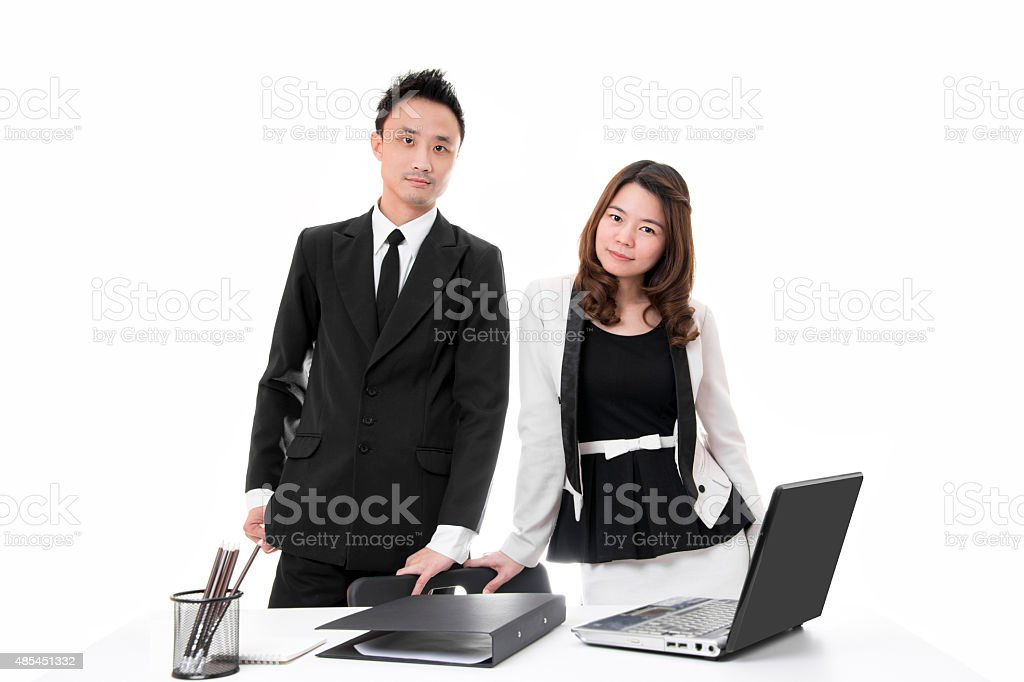 Smart Business People Standing Behind Table in Office royalty-free stock photo