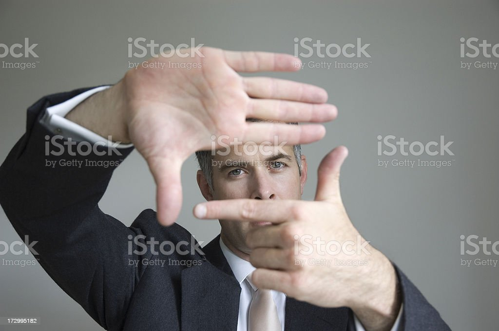 Smart businessman focusing. royalty-free stock photo