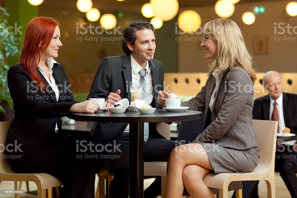smart businessman with businesswomen at coffee table royalty-free stock photo