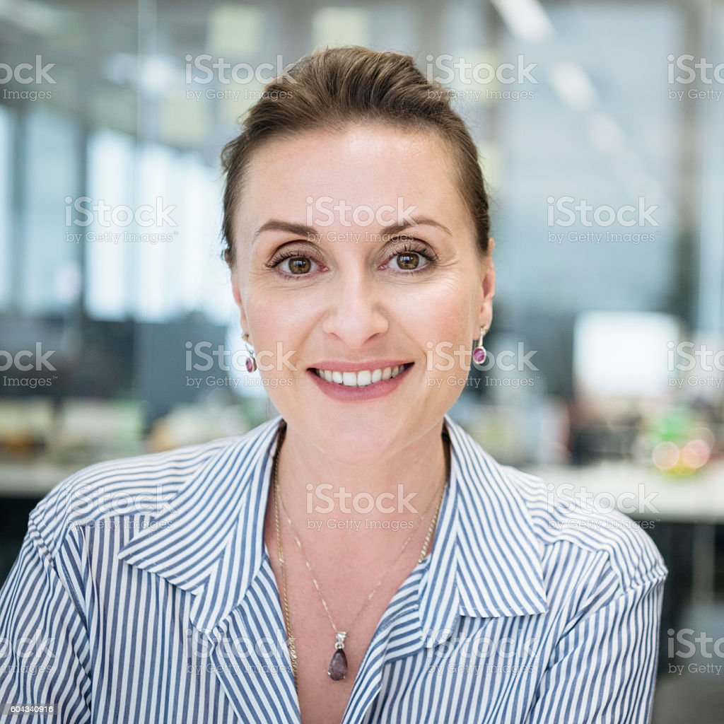 Smart businesswoman smiling towards camera, portrait stock photo