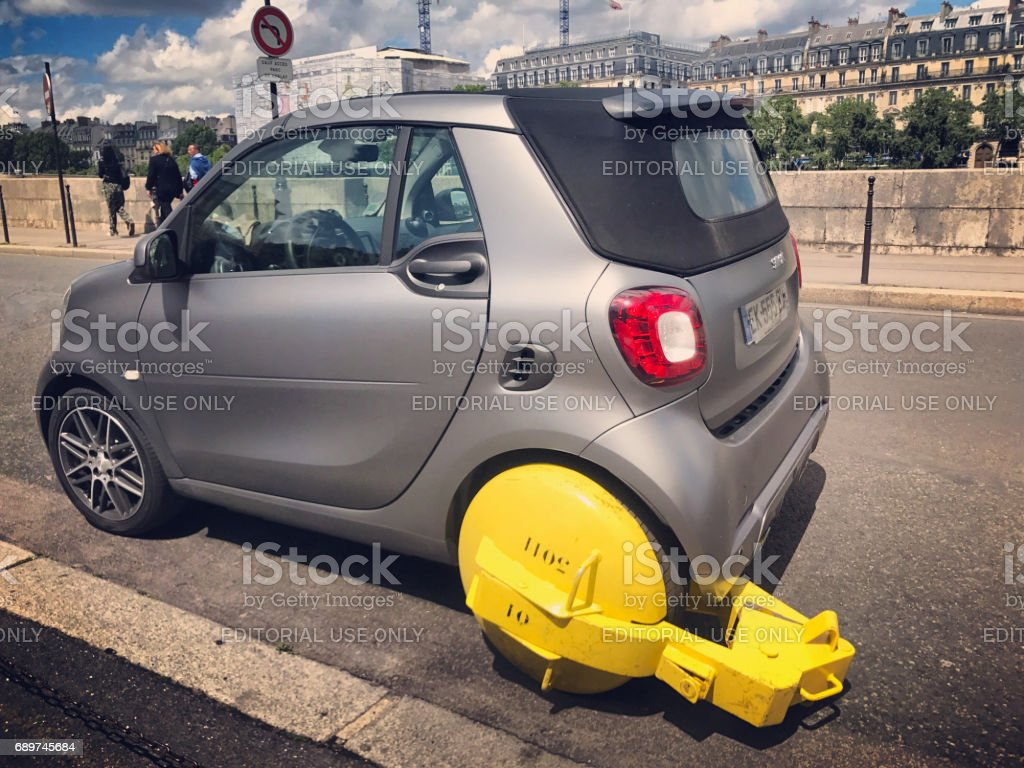 Smart car caught for wrong parking on Seine river embankment, Paris, France stock photo