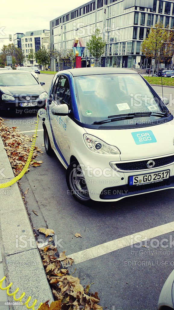 Smart car getting energy stock photo